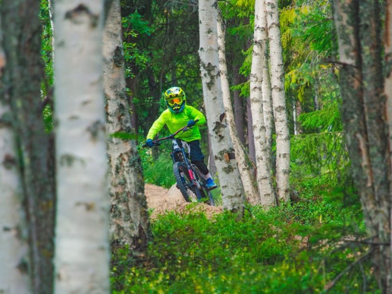 Family riding in Järvsö Bergscykelpark, Hälsingland, Sweden.