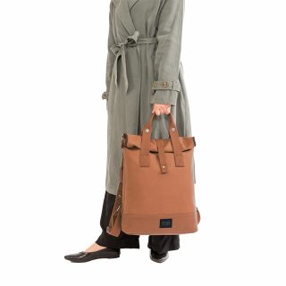 City Backpack Cognac model holding